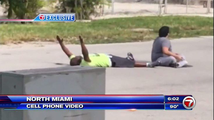 A behavioral therapist trying to help his autistic patient was shot by police while lying on the ground with his arms raised in the air. A video recorded on a cell phone, which you can watch above, shows the moments before the shooting in North Miami, Florida.  The victim, Charles Kinsey, who is black, is recovering in the hospital, WSVN-TV reports. The news station obtained the video of the Monday shooting on Wednesday.