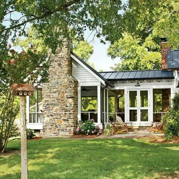 Large enclosed porch with fireplace. Modern tin roof.