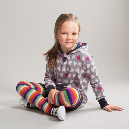 Tunic made of our new jacquard knit with soft hearts design. The hoodie has a colourful multi stripe lining.