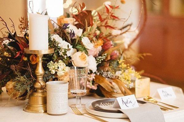Orange and yellow centerpiece  #wedding #weddings #weddinginspiration #engaged #aislesociety #winterwedding