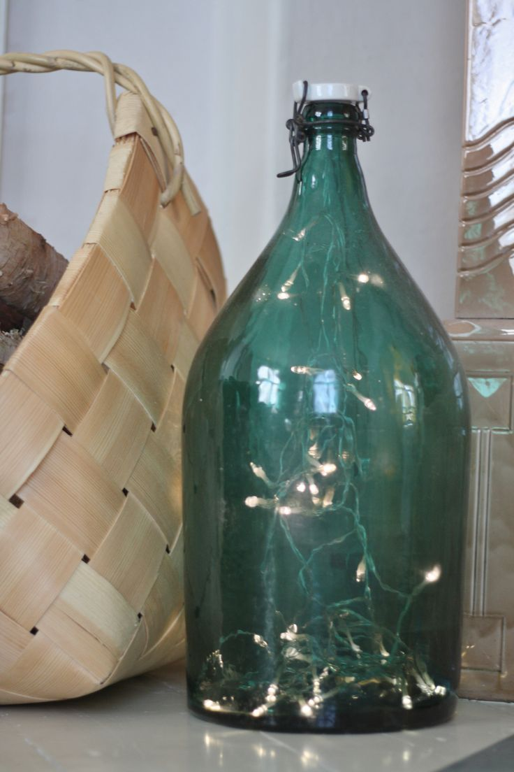 Twinkle lights inside an old seafoam colored bottle