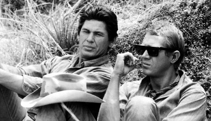 Charles Bronson, Steve McQueen / during production of John Sturges's The Magnificent Seven (1960)