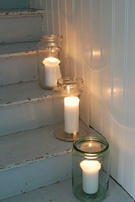 Candles in jars--simple and atmospheric decor for a minimalist home.