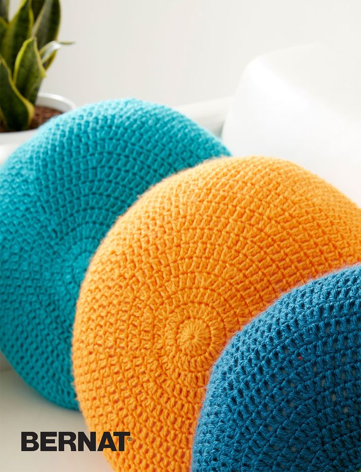 Colorful pillows are a great addition to any room - and an easy way to switch up your colors, easily! These pillows are easily crocheted in Caron Simply Soft. | Full Circle Pillow | Crochet Pillow