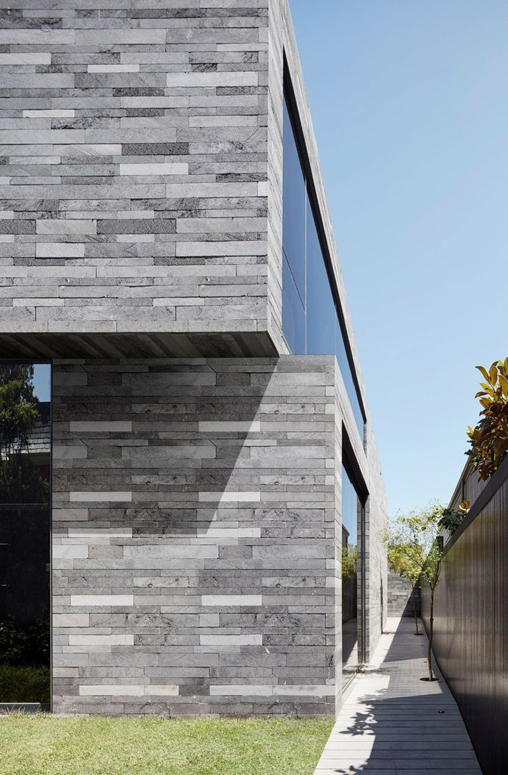 .This new home is covered in lava stone inside and out.  Interesting use of lava stone!  A little stark inside but I do like the material