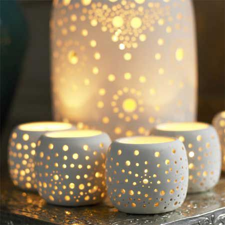 ceramic candle holders... I adore    This would look really cool if they were certain constellations. Either Alaskan constellations or zodiac ones