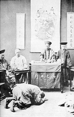 """Chinese History - Kowtow, which is borrowed from kòu tóu in Mandarin Chinese, is the act of deep respect shown by kneeling and bowing so low as to have one's head touching the ground. An alternative Chinese term is ketou, however the meaning is somewhat altered: kòu has the general meaning of 'knock', whereas kē has the general meaning of """"touch upon (a surface)"""", tóu meaning head."""