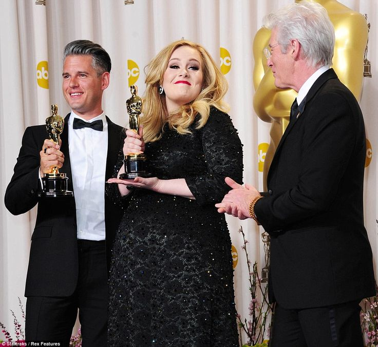 It's all mine! Adele can't hide her delight as she poses with fellow songwriter Paul Epworth and Richard Gere, who presented their award