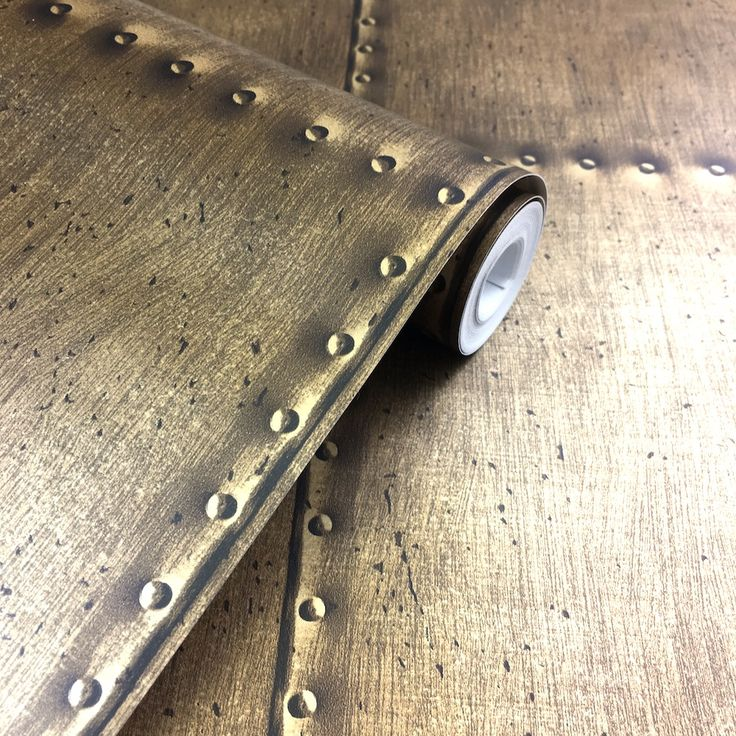 This on trend brass coloured sheet metal wallpaperis perfect for creating an industrial style room. It's paste the wall too, making it quick and easy to hang.
