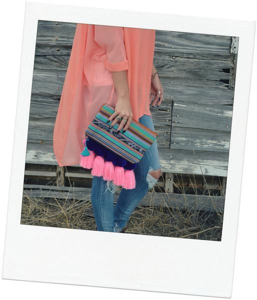 """This is a head turner! Dress any outfit up with this adorable clutch. 12.5"""" H, 7.25"""" H when folded, 11"""" W, .5"""" D Tassel length: 6"""" Style Number NSIX1001"""