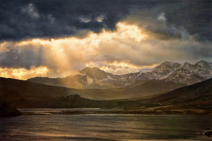 Heavenly sunbeams illuminate one of Britain's most famous mountain ranges... the Snowdon Horseshoe.
