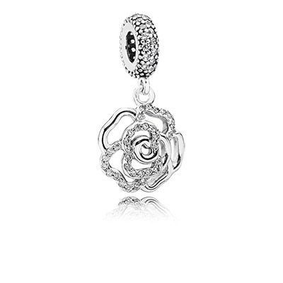 This sterling silver rose dangle charm, a dazzling addition to PANDORA's romantic range of floral charms, will look fabulous as the showpiece in your bracelet or as a necklace pendant. #PANDORAcharm