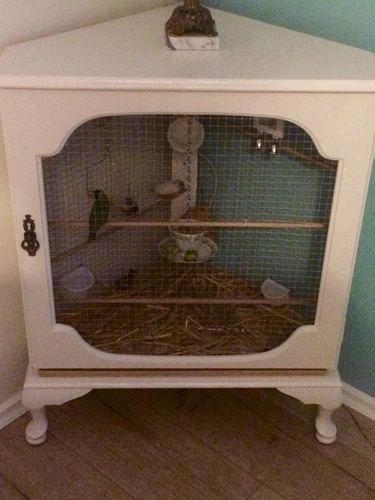 Pet Bird Cage Ideas... Bird aviary from a corner cabinet