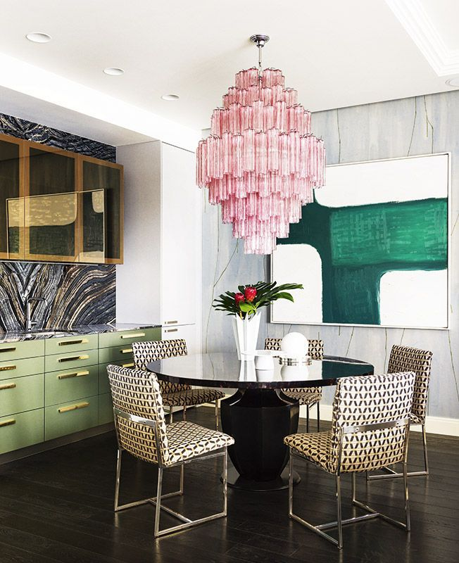 Gorgeous pink chandelier and green accents in