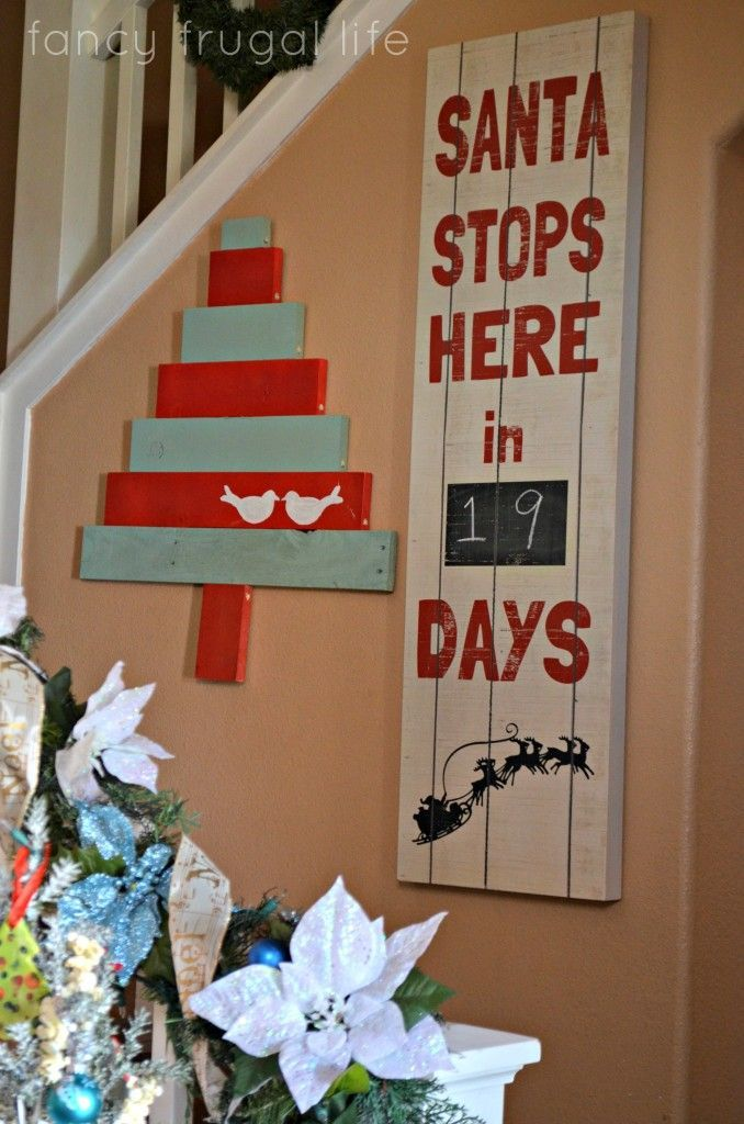 Santa stops here sign. I love the simplicity of this and how rustic it is. From Kirklands........D. (14-48-60)