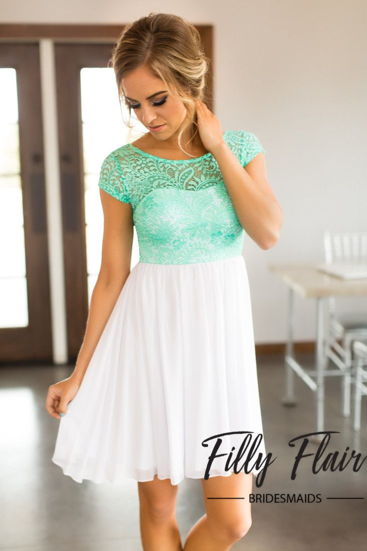 This gorgeous mint top lace dress will be darling for spring! The white lace chiffon skirt is soft and flowy! This boutique quality lace dress will be a trendy pick for any occasion! 100% Polyester FI