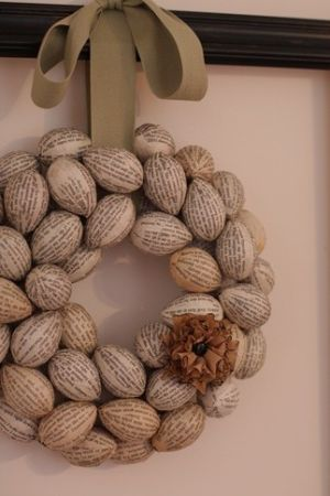 wreath made of plastic eggs covered in book pages!--- would be fabulous done with styrofoam balls! by betsy