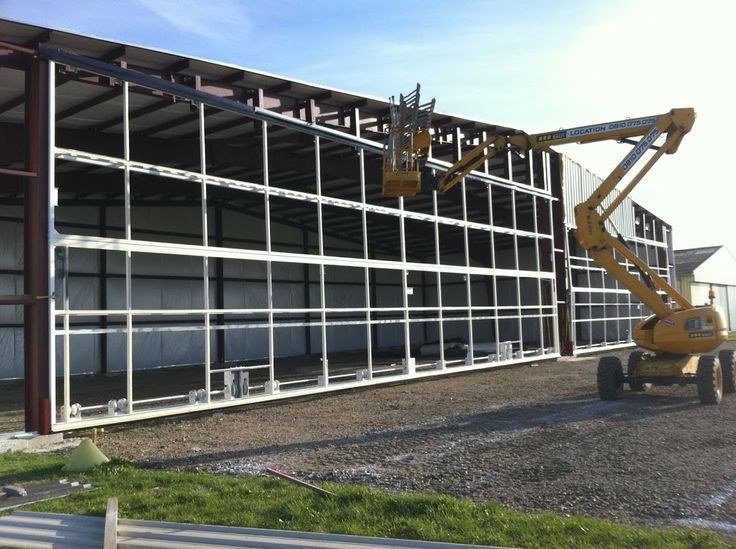Schweiss hydraulic door was lifted up to meet up with the heavy duty Schweiss Door hinges which go across it. A Telehandler or Lull makes the job easy. & 9 best 39 Aviation experts in France rely on Schweiss Doors images ...