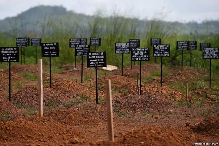 Tombstones are seen at a cemetery at the Kenama Ebola treatment centre run by the Red cross Society in Sierra Leone