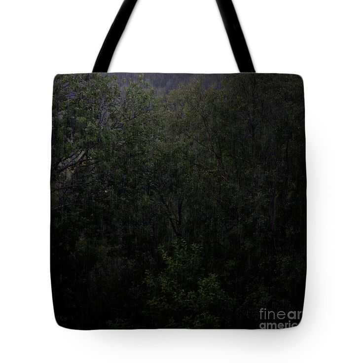 Dark Forest Rain Tote Bag by Sverre Andreas Fekjan.  The tote bag is machine washable, available in three different sizes, and includes a black strap for…