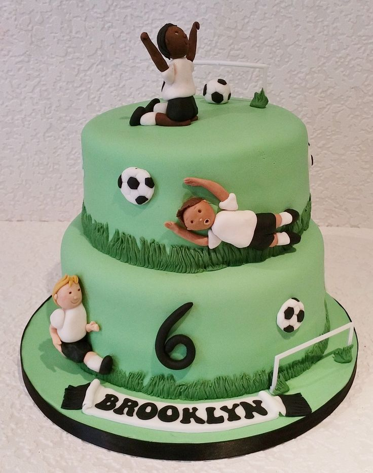 Football themed cake by Baking Angel