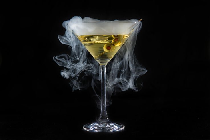 Smoking martini glass on black background. I used liquid ...