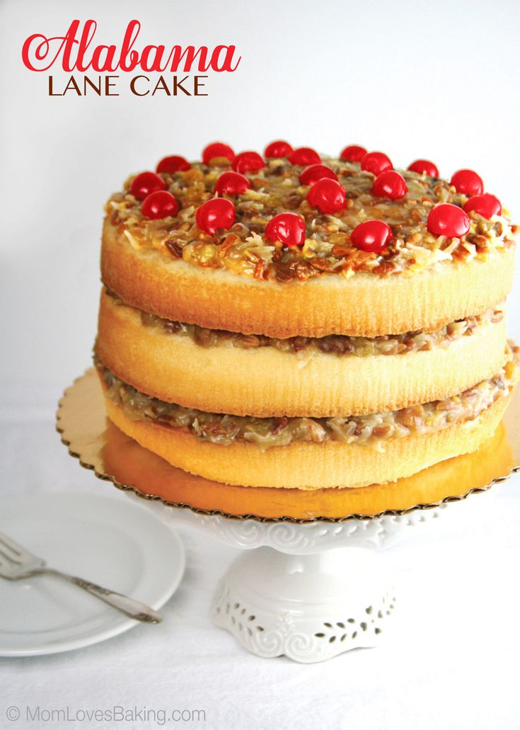 Soaked in bourbon, the layers of this Alabama Lane Cake are filled with pecans and topped with cherries.