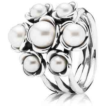 Wishful Thinking Pearl Ring - Pearls are given on the third and 30th anniversaries, and are said to lift your spirits, and encourage relaxation and beauty. This floral ring is made in sterling silver with seven white freshwater cultured peg-set pearls. A timeless elegant addition to a any collection.