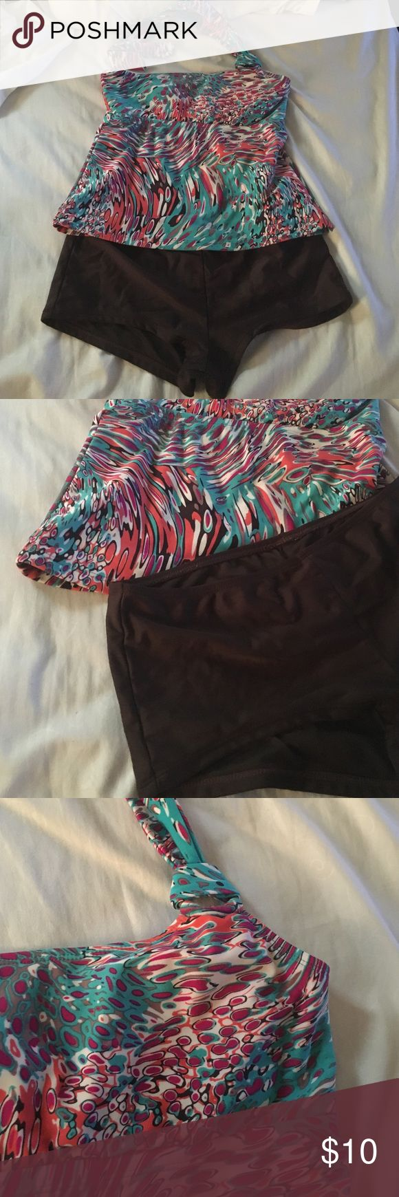 Tankini Tankini with brown boy short bottoms. Top has abstract pattern with brown, teal, orange, purple, and cream colors. Tags have been cut off but top is a small and bottoms are medium. Swim Bikinis