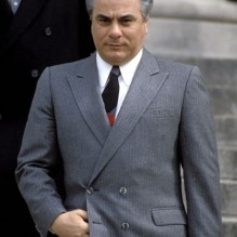 """John Joseph Gotti, Jr. was regarded as Gambino's Family Underbooss, Agnello Dellacroce's protégé. In 1986 John Gotti became the boss of the Gambino Family after the death of Paul Castellano, who was the boss at the time. John Gotti was also known as """"The Teflon Don."""" In 1998 Gotti was diagnosed with throat cancer and died on June 10, 2002."""