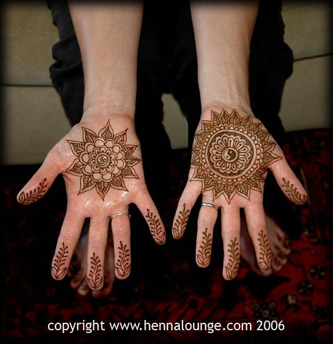 Om and yinyang design in henna