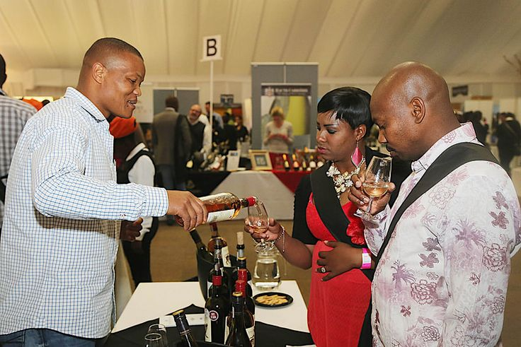 Mike, Lucy and Enocent taste wine at the 10th TOPS at SPAR Soweto Wine and Lifestyle Festival, presented by Joburg Tourism.