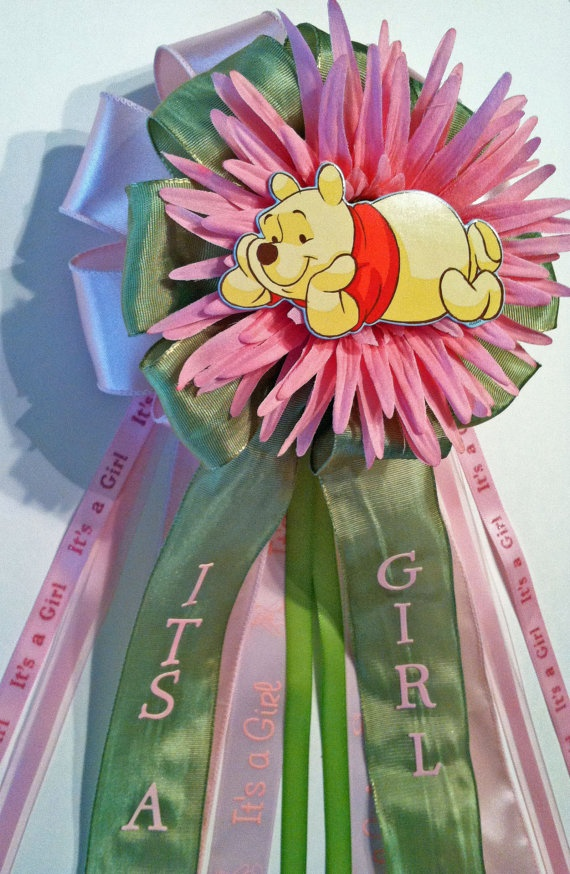 Winnie the Pooh Baby Shower Corsage by littlecreationz on Etsy.  I like this one over the one's on the webpage.