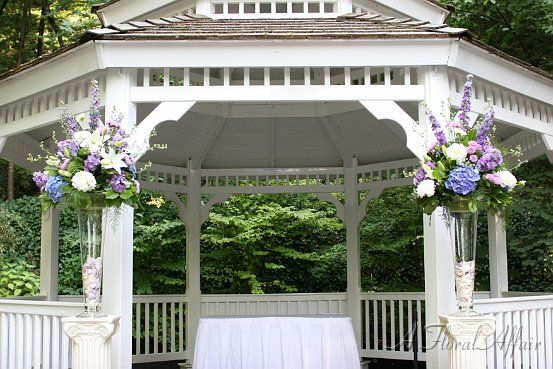 Lavender, White and Blue Garden Wedding Flower Arrangements www.afloralaffair.com