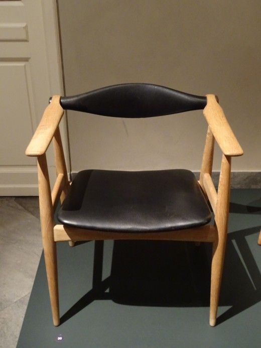 low back chair. timber and leather