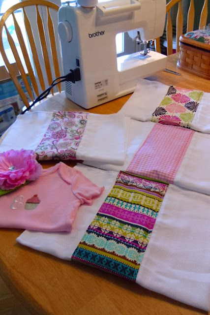 """I just bought a 6-pack of cloth diapers and 4 cute patterns of fabric 1/8 yard each. I cut them down to fit over the center of the cloth diapers and iron an 1/4"""" edge under and pinned the fabric down. I sewed all the edges and that's it! Plus more Easy Sewing Projects on her blog...Pin Now, Look Later"""
