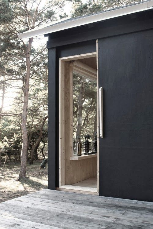 A beautiful basic weekend cabin -- great black exterior with the timber