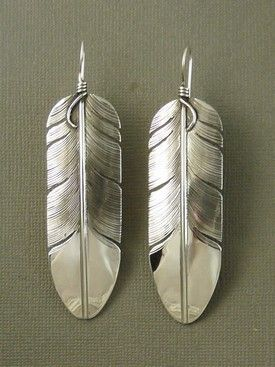 "Large Sterling Silver Feather Earrings by Lena Platero from Southwest Silver Gallery. These beautifully, detailed statement earrings are a little over 3"" in length. The silver feather earrings are eye-catching converstion pieces due to the quality of her work. We, also carry Lena Platero's silver feather rings, pendants, and earrings. http://www.southwestsilvergallery.com/AWSCategories/p/408/Lena-Platero-Silver-Feather-Jewelry"