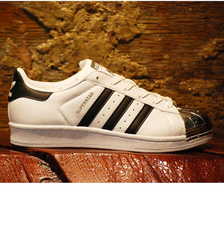 Classic Adidas Superstar in white with black stripes and gold logo. Adidas  original mens and womens.