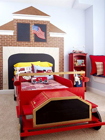 On Fire - Take a fire truck theme one step further with a firehouse headboard. A wall mural is a great way to top a bed and add to a room's theme. Here, the fire truck bed is pushed against the wall and the brick firehouse mural surrounds it.