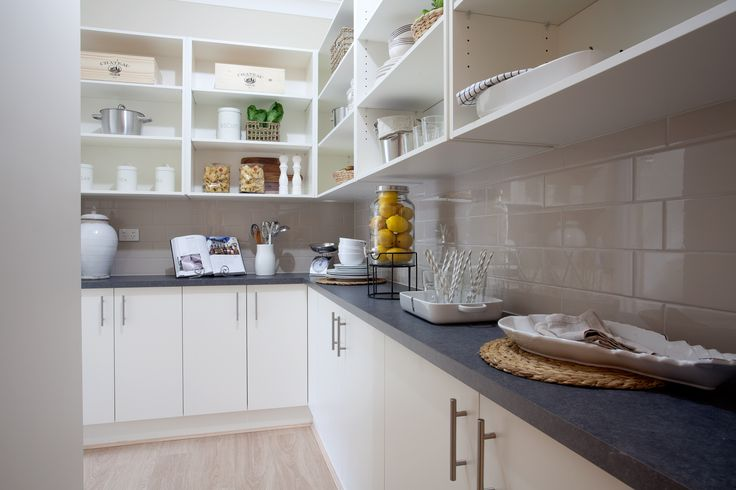 What a stunning walk-in pantry.
