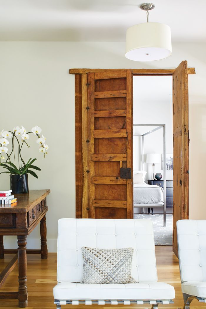 A striking pair of antique doors from an old Mexican church divides the  living area and entry from a guest room. - 114 Best Living Rooms Images On Pinterest Living Spaces