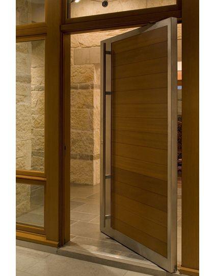Wood Pivot Front Door With Steel Frame.