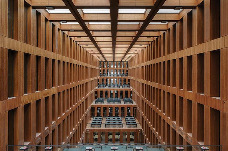 JACOB AND WILHELM GRIMM CENTRE, HUMBOLDT UNIVERSITY BERLIN Designed by Max Dudler, 2009. Named after the Brothers Grimm, the interior features an atrium with a glass roof, enveloped by five stories of cherrywood terraces.