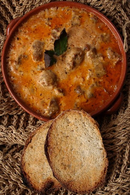Tave Dheu, is an Albanian dish with liver and tomatoes. Something to try if you are not a vegetarian. http://www.outdooralbania.com