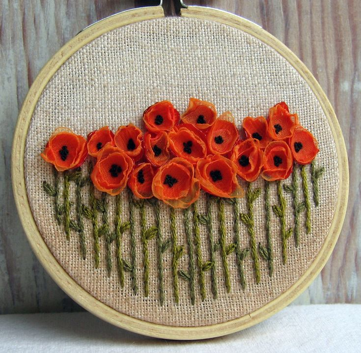 Orange Poppy Field Hand Embroidered Wall Decoration    3 inch hoop    A field of bright orange poppies made with ribbons and hand embroidery. Done on natural tea dyed linen secured in a 3 inch hoop and backed with white felt for a more finished look.    Thank you for stopping by,    Lynn    You can find more of my listings here: http://www.sidereal.etsy.com