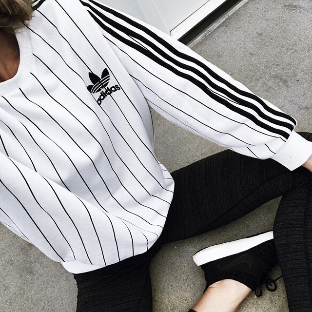 Pin for Later: 37 Genius Ways to Wear Stripes Every Day On a Sporty Designer Sweatshirt