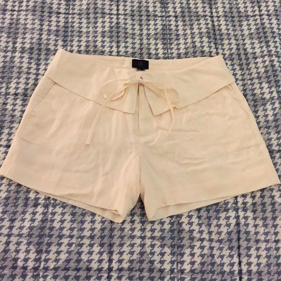 Banana Republic dress shorts Banana Republic dress shorts. Built in short slip. Never Worn. Perfect Condition. Beautiful soft cream/light pink color. Banana Republic Shorts
