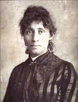 """Lucy Parsons (circa 1853–1942)  Labor organizer, socialist, and legendary orator. Lucy was of Native American, Black, and Mexican ancestry, born in Texas as a slave. She moved to Chicago where she was a key organizer in the labor movement and also participated in revolutionary activism on behalf of political prisoners, people of color, the homeless, and women. She said, """"We [women] are the slaves of slaves. We are exploited more ruthlessly than men."""""""