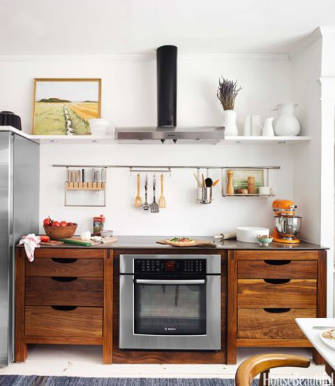 Crocks of spoons and spatulas can certainly be stylish, but they get in the way. In this Scandinavian-inspired kitchen designed by Susan Serra, a few choice utensils hang neatly over the stove.